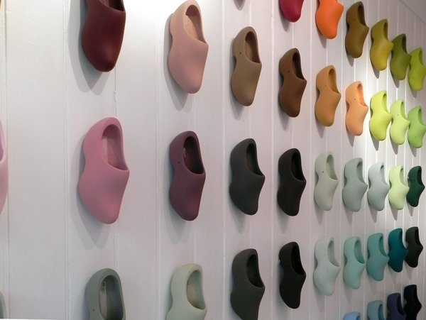 All 60 of Simon's Siecle paint colors are displayed on clogs that cover the entire left hand wall of the shop in a rather striking display. Displaying them on a 3D shape instead of a flat card allows customers to see the colors in different degrees of light.