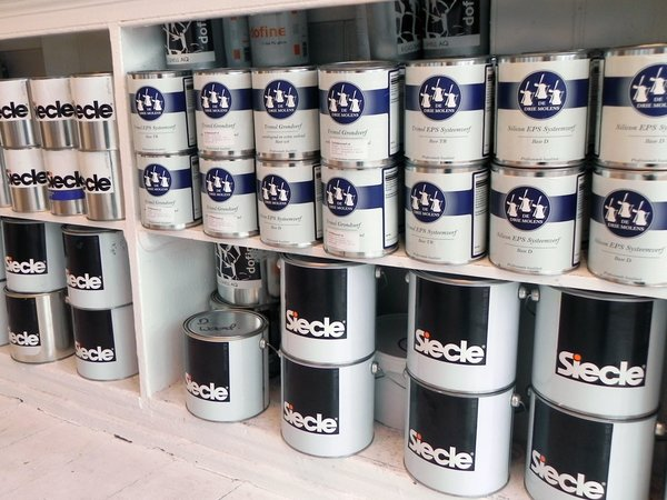 """All of Simon's own brand Siecle paint is made in Holland to his own specific ratios of resin, chalk, and water. """"The company I work with makes it in a machine that looks like a giant Kenwood mixer.""""<br><br>As well as his own special blend, Simon also sells Dutch paint De Drie Molens. """"I like these guys. They're really, really old. Holland is the home of paint making it has been for four hundred years. The only way to tell a good paint is to see whether it's still on the outside wall of your house after six years."""""""