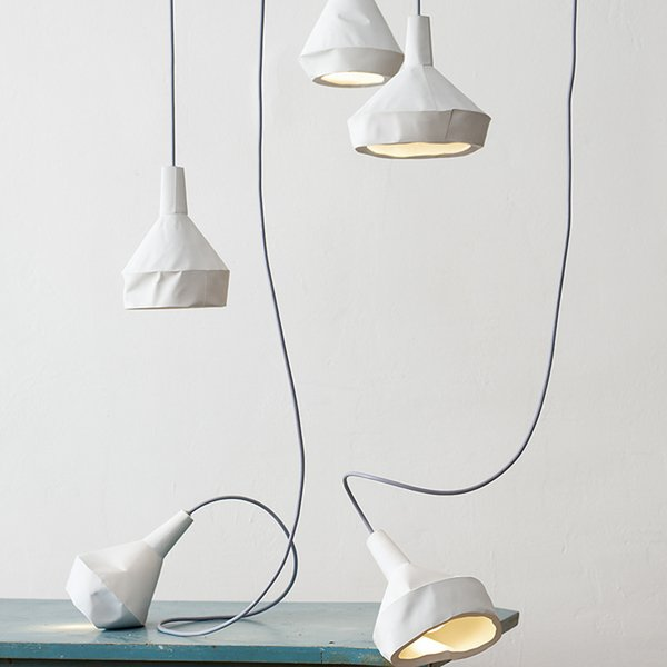 Thought these lamps by Miriam Aust and Sebastian Amelung appear to be featherweight paper, they're actually concrete!