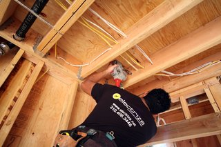 Dwell Home Venice: Part 13 - Photo 2 of 10 - Joe Barrientos from Electrize is the electrician on the project. Here, Joe is shown drilling holes for pulling electrical wiring in the southern guest bedroom.