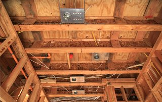 The master wardrobe ceiling shows the fire sprinkler head interrupting the pattern of light housings. These recessed lights from lumens.com will be re-spaced so they can co-exist with the sprinkler. Resolving code compliance with design intent can be tricky.<br><br>Click here to read past installments of Dwell Home Venice.