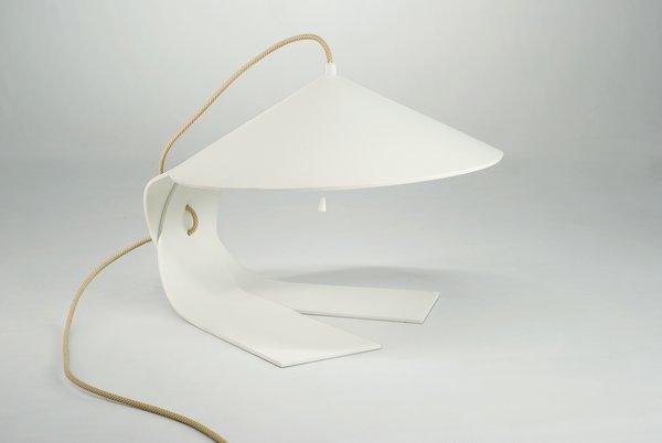 The Hanoi lamp by Federico Churba is manufactured by the Italian lighting company Prandina.