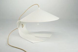 The Hanoi lamp by Federico Churba is manufactured by the Italian lighting company Prandina.