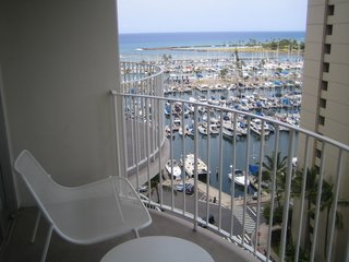 The Modern Honolulu - Photo 12 of 12 - Here's the view of the Marina from my room on the 12th floor. I didn't have an unobstructed view of the ocean, but clearly the Pacific is still pretty evident. I also liked the very comfy chairs from Emu.