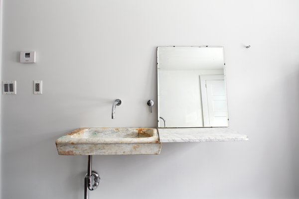 In the guest bathroom, Givone installed a hand-chiseled sink made of 17th-century marble quarried from the hills outside of Rome.