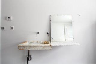 Hope Floats - Photo 10 of 12 - In the guest bathroom, Givone installed a hand-chiseled sink made of 17th-century marble quarried from the hills outside of Rome.