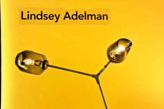 Dwell favorite Lindsey Adelman contributed a stunning floor lamp in vintage brass with a grey globe and grey pod.