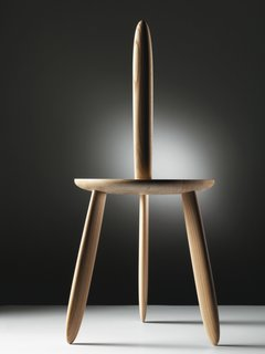 Bakker's 2010-2011 3dwn1up stool is crafted from elm and comprises a seat and four legs, one of which functions as an unconventional backrest