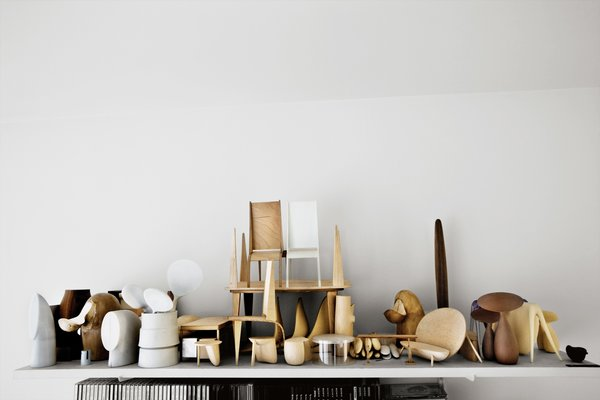 """""""Every material has its own beauty, but I'm mostly drawn to wood because of its variety of texture, smell, and color,"""" Bakker says. Maquettes made of balsa wood and plaster are displayed in his studio and are used as guides for skilled Dutch or European artisans who produce the finished pieces in silver, glass, ceramic, and copper."""