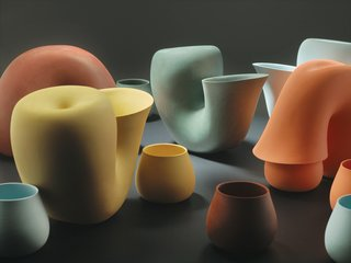 "Bakker's girlfriend, fashion and furniture designer Brecht Duijf, sometimes suggests colors for designs. ""I would not have been able to think of these colors,"" Bakker says, holding up tiny ceramic chips she selected to determine the palette for Jug, a water carafe with a neck bent over a drinking cup, looking like a primordial creature feeding its young."