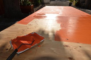 The Making of Screenplay: Part 5 - Photo 3 of 7 - Painting the base coat bright orange.