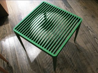 "The experimentation and technical capabilities of Neal Feay's factory inspired the designers. ""When I got to the factory my brain was churning immediately,"" Ascalon says.<br><br>A nod to Neal Feay's claim of ""Making Music from Metal,"" this side table - in green and grey - provides a playful visual surprise when one walks around it."