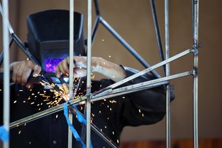 Welding precise connections. Photo by Teri Yu.