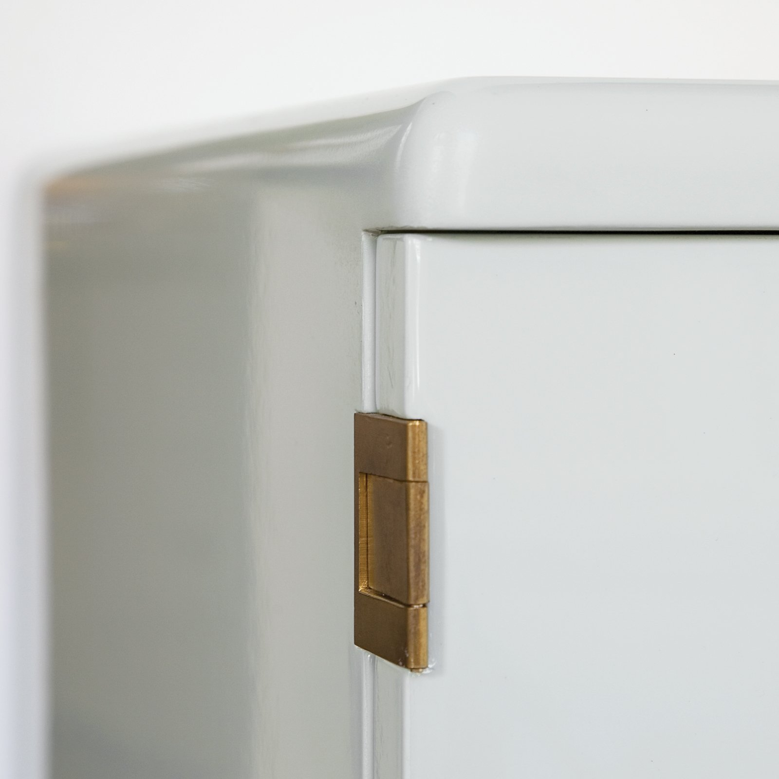 """Brass Tactics  The best way to showcase vintage hardware is to polish it lightly and paint door and window frames a pale white or gray, according to Hayon. Brass hardware also effectively accents mint-colored furniture like the Bisazza Bagno cabinet in the living room, a Hayon design from 2011.  Photo 1 of 7 in """"A Home Should Never Feel Like a Hotel Lobby"""""""