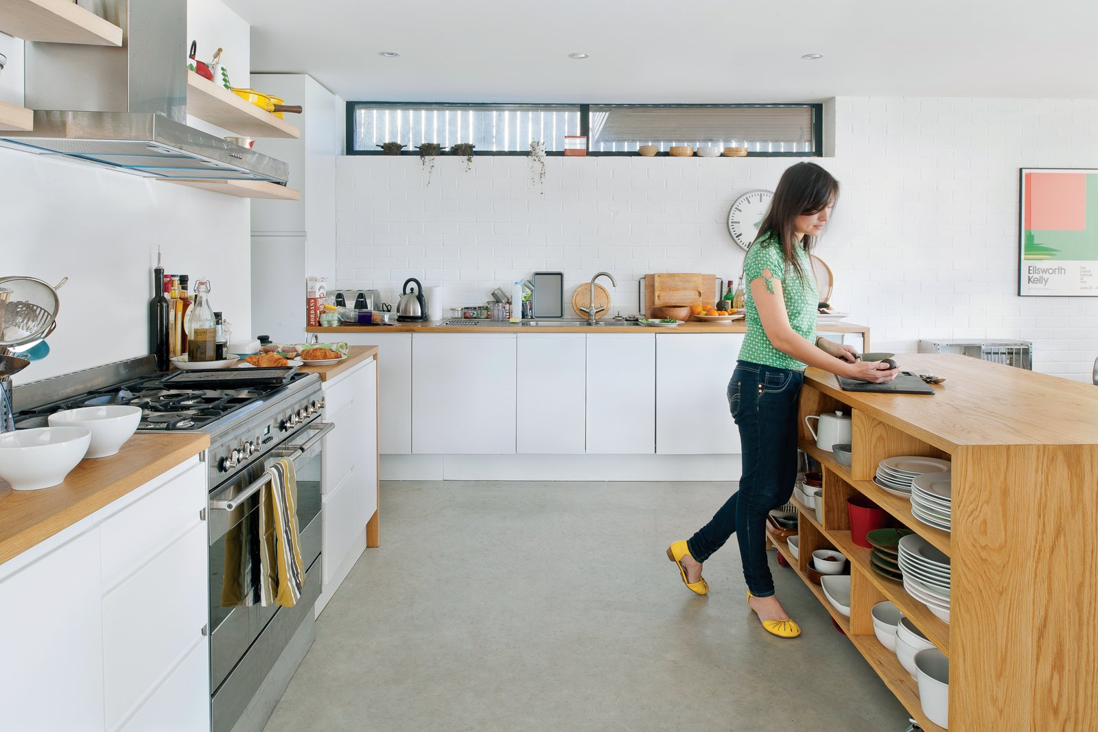 """About her collection of cookware, Tyler comments: """"I use accessories as the color in spaces so these items are an integral part of the overall design."""""""