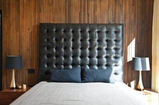 "You Won't Be Calling This House a ""Man Cave"" - Photo 5 of 9 - The master bedroom's massive leather headboard was Thompson's idea and design."