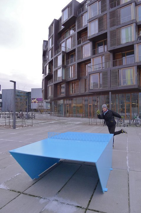 This photo shows Maynard himself posing near a ping pong table outside the dorm. Photo by Kevin Hui. Three Buildings: Andrew Maynard - Photo 3 of 4