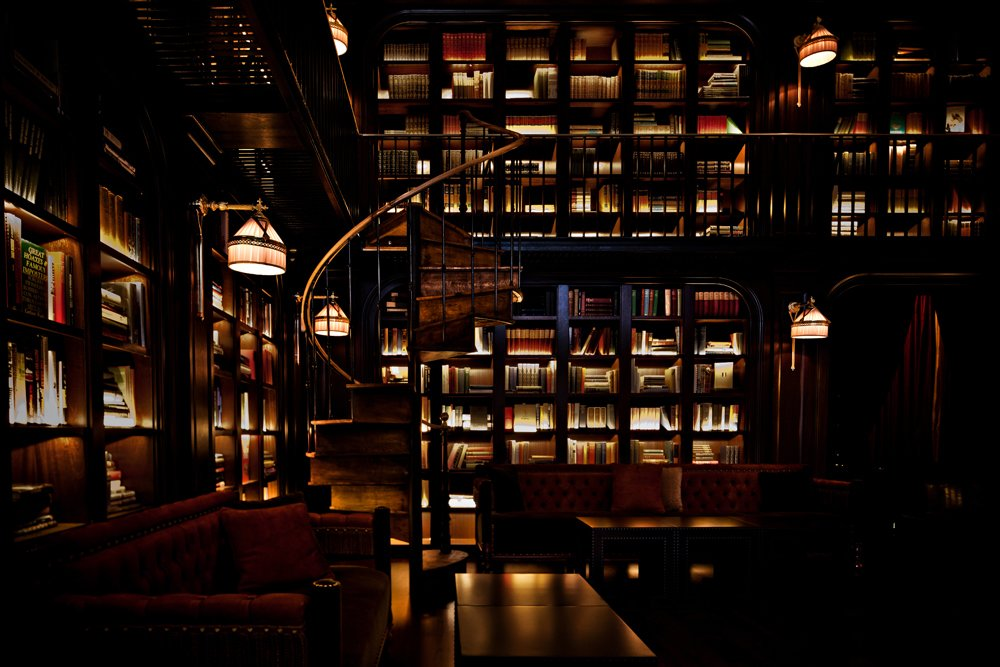 Here, the Library Bar, which is equally dark and richly textured, a marked difference from the scruffy Garment District neighborhood right outside.  Read by DAVE MORIN from The NoMad Hotel, New York