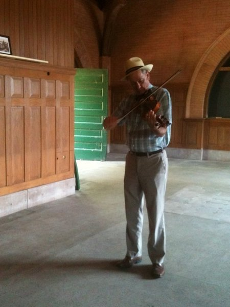 Kirk Brandenberger plays the fiddle in the Keokuk Union Depot.