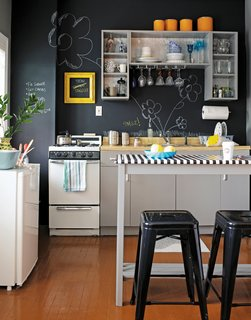 The First Apartment Book: Cool Designs for Small Spaces - Photo 3 of 3 - This kitchen manages to look playful and edgy with chalkboard paint: the matte black is crisp, but the scribbles add whimsy. Reprinted from The First Apartment Book by Kyle Schuneman. Copyright © 2012.  Published by Clarkson Potter, a division of Random House, Inc.