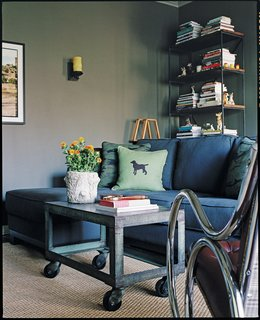 The First Apartment Book: Cool Designs for Small Spaces - Photo 2 of 3 - The jute rug and industrial coffee table in this living were chosen not only as design elements, but as sensible solutions to the owner's dog. Natural fiber rugs are not very absorbent, which gives you more time to clean up accidents.  Reprinted from The First Apartment Book by Kyle Schuneman. Copyright © 2012.  Published by Clarkson Potter, a division of Random House, Inc.