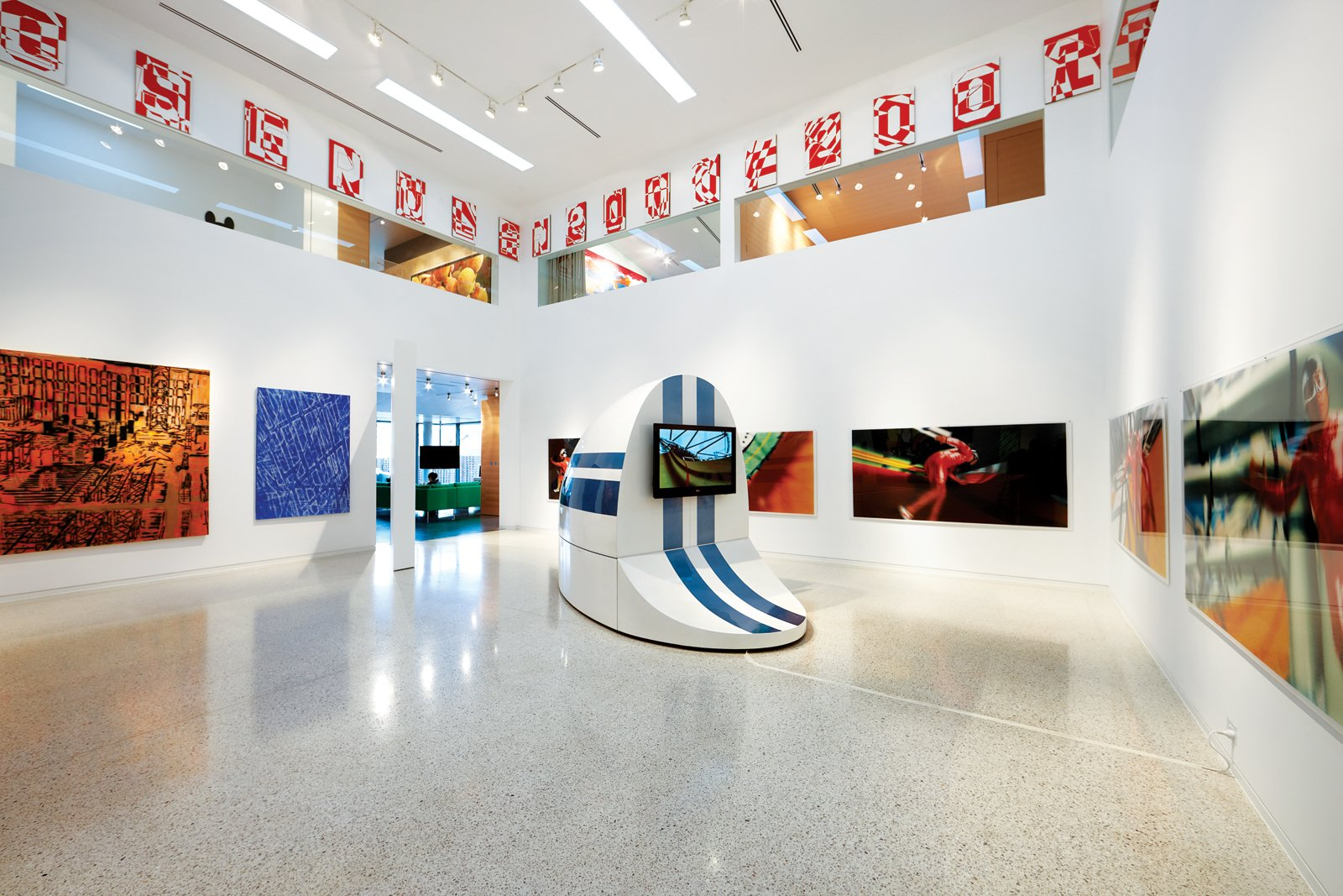 """The """"white cube"""" gallery space off the dining area displays work by contemporary Australian artists including Louise Forthun and Patricia Piccinini. Clerestory windows   offer glimpses into   the second-floor library and private bedrooms."""