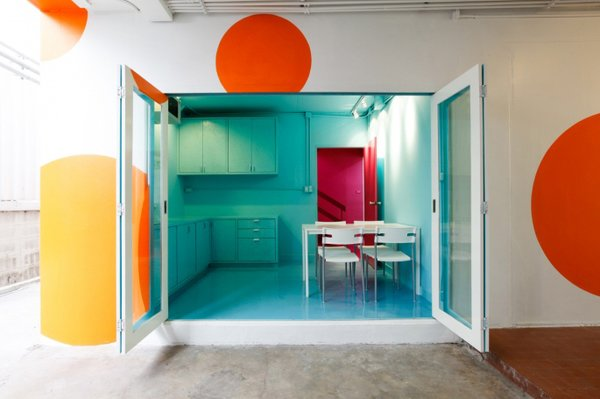 What was once a childcare house for Bangkok University is now an creative office space swathed in electric colors.
