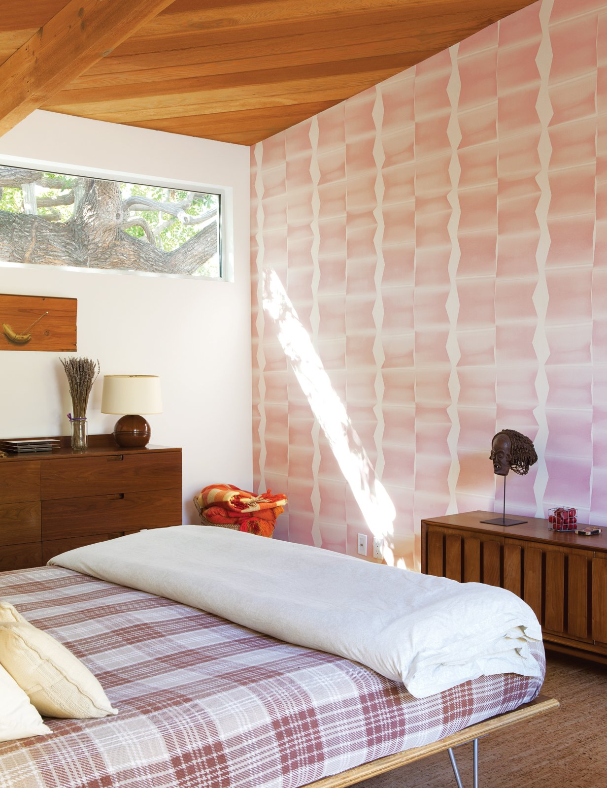 The master bedroom features a Case Study bed from Modernica. Tagged: Bedroom.  Photo 8 of 13 in A Fresh Dose of Color Livens Up This Midcentury Los Angeles Home