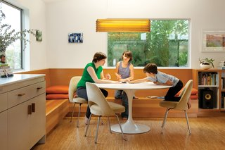 A Fresh Dose of Color Livens Up This Midcentury Los Angeles Home - Photo 3 of 13 - Purdy, Eva Luna, and Simon play cards under a Louvre Light by Established & Sons.