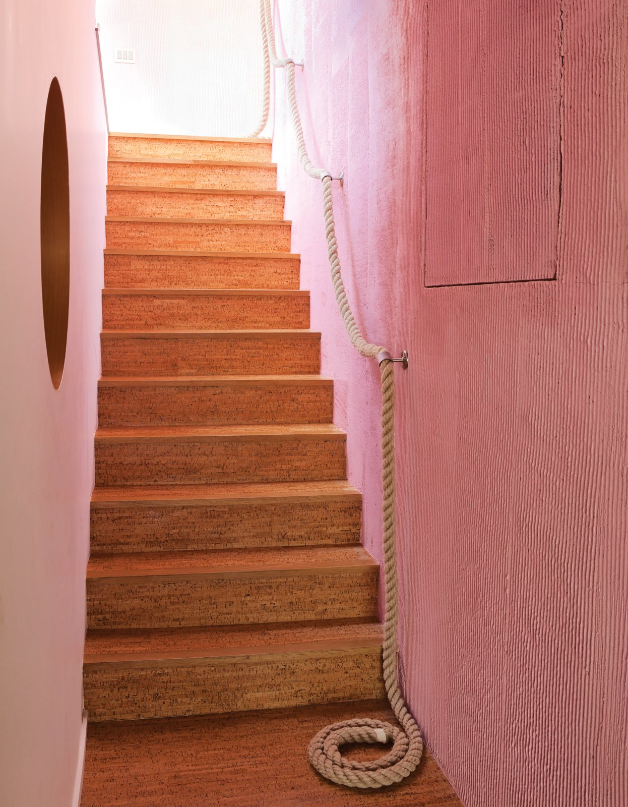 The cork stairs with a rope railing lead down to the kids' level. Tagged: Staircase and Wood Tread.  Idea not Ikea by Numchok Kamwan from A Fresh Dose of Color Livens Up This Midcentury Los Angeles Home