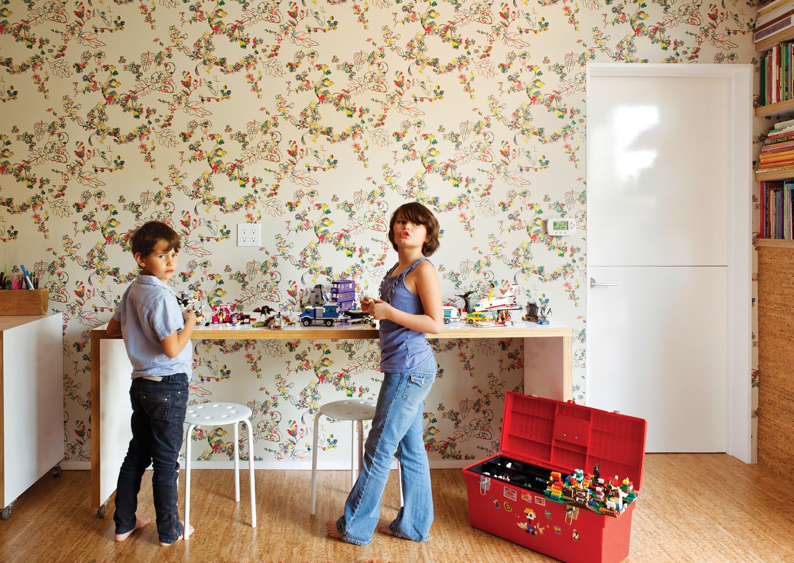 Simon and Eva Luna play in front of a wall covered in Daks wallpaper from Walnut.  Photo 10 of 13 in A Fresh Dose of Color Livens Up This Midcentury Los Angeles Home from Wallpaper That Fixes Walls