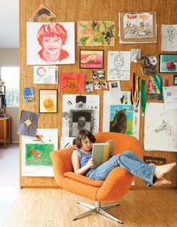 The pair's art covers a cork wall where Eva Luna reads in a vintage Danish lounge chair.