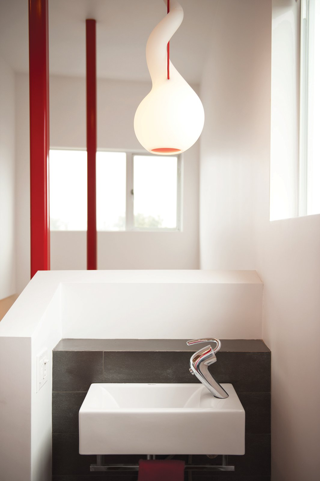 The Alien pendant light with red cord is by Constantin Wortmann for Next Design.  Photo 6 of 13 in 131-Day House