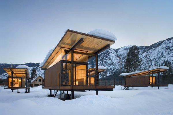Olson Kundig designed the Rolling Huts in Mazama, Washington, for a client who needed space to house visiting friends and family. The huts sit lightly on the site, a former RV campground in an alpine river valley. The huts are sited to capture views of the mountains and not one another.