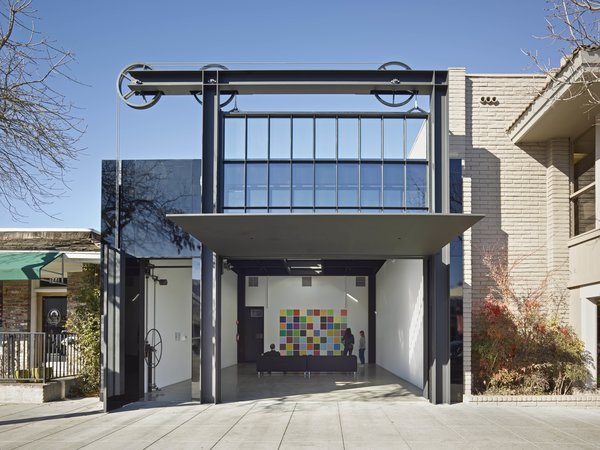 Olson Kundig refurbished this 1950s building as a flexible off-site exhibition space for SFMOMA's Project Los Altos in downtown Los Altos, California. The firm replaced the front facade with a double-height, floor-to-ceiling window wall that can be raised or lowered at the whim of the user.