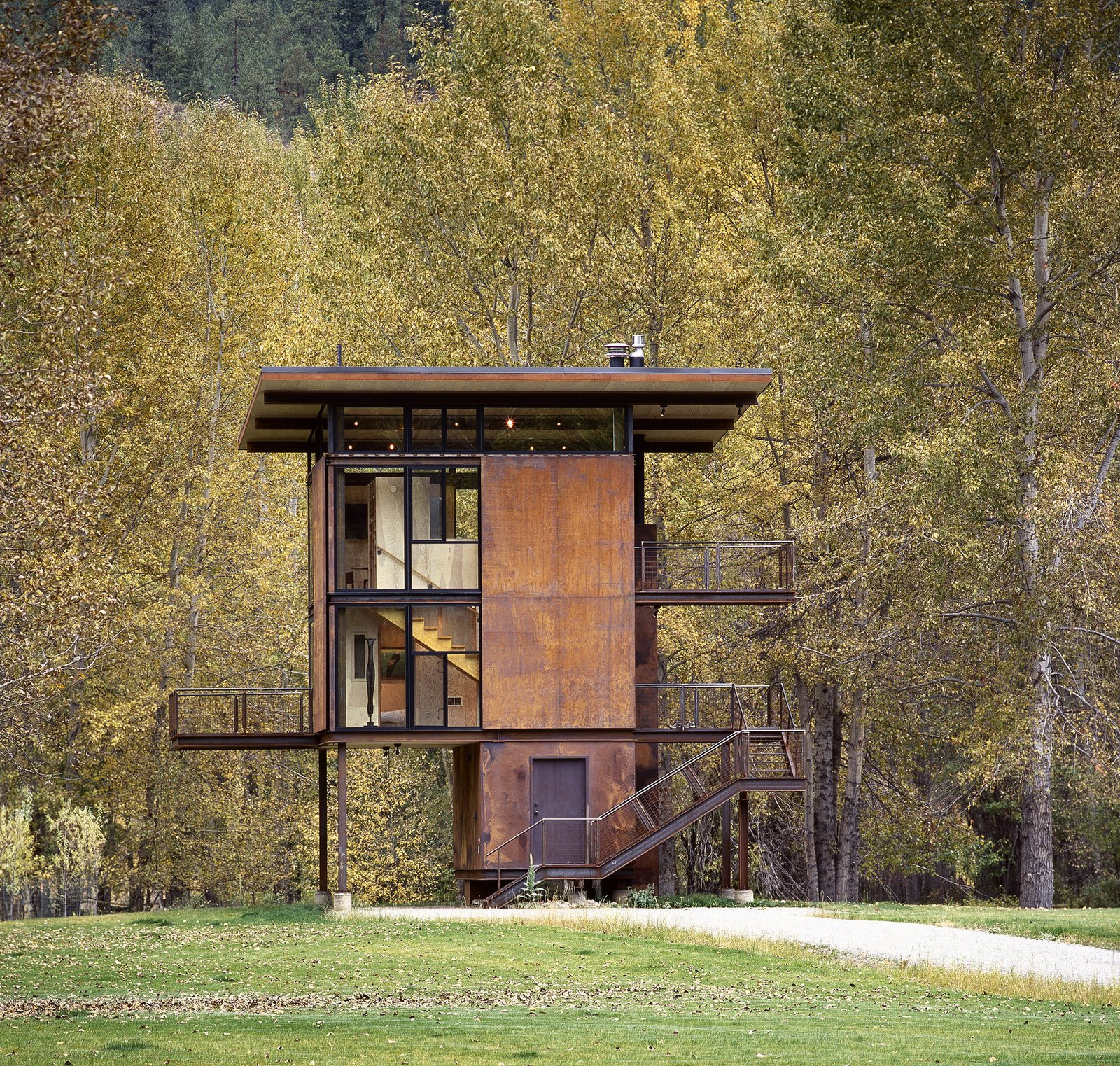 "This 1,000 square-foot weekend cabin in Mazama, Washington, is essentially a ""steel box on stilts,"" according to the firm. The three-story structure, which includes a living room and kitchen, can be completely shuttered when the owner is away. Tagged: Exterior, Cabin Building Type, Metal Siding Material, and Flat RoofLine.  Photo 76 of 101 in 101 Best Modern Cabins from In Omaha, an Exhibit Celebrates 50 Years of Olson Kundig"
