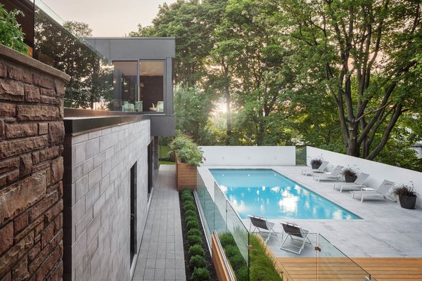 "The architects sited the patio and swimming pool beneath a canopy of mature maple trees, an element that they say makes the site ""an oasis in the heart of the city."" Photo 2 of Prince-Philip Residence modern home"