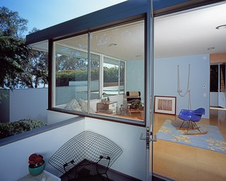"""A Neutra Renovation in Los Angeles - Photo 6 of 6 - The upstairs portion of the addition takes advantage of the ocean view beyond. """"The second floor achieves a dynamic on its own, with large window bands and roof overhangs with detailing emulated from the original,"""" Grueneisen says. """"But despite the significant change in the massing, we believe the final composition results in an integrated and seamless sense of continuity between the different generations of the building."""""""