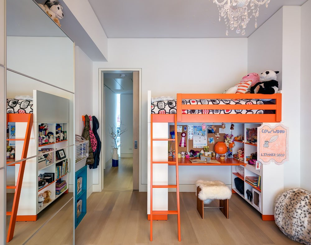 The kids' bedroom features playfully colored bunk beds from Ikea. The mirrored closet doors reflect light and make the room appear larger. The vertical light slot can also be viewed through the bedroom corridor.  Bedrooms by Dwell from Ways to Design with Ikea Furniture