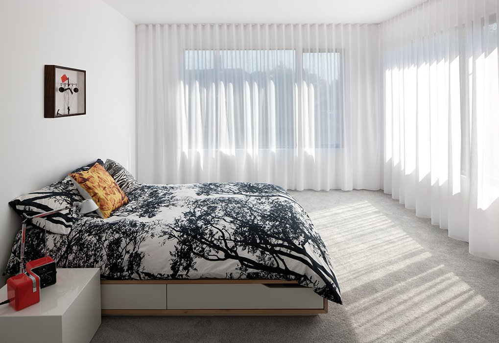 In the master bedroom, a Mandal bed from Ikea is draped with a Tuuli duvet cover by Marimekko.