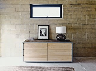 Ingenious New Building Method Replaces Concrete Block with Rammed Earth - Photo 6 of 10 - The earth bricks are a dominant visual element in the master suite, which is furnished with a dresser from Room & Board.