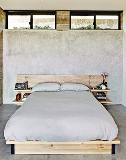 Ingenious New Building Method Replaces Concrete Block with Rammed Earth - Photo 7 of 10 - The master bedroom sports a custom birch bed.