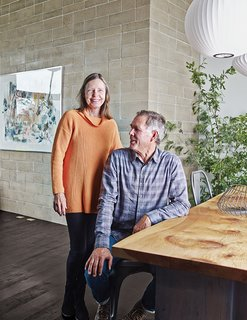 Ingenious New Building Method Replaces Concrete Block with Rammed Earth - Photo 8 of 10 - Easton and Wright in their dining room. The redwood flooring in the living and dining rooms continues onto the deck.