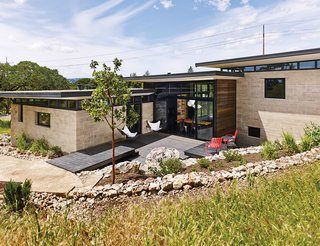 Ingenious New Building Method Replaces Concrete Block with Rammed Earth - Photo 9 of 10 - The deck serves as a vantage point for admiring the California lilacs, manzanitas, and other native plants on the property.