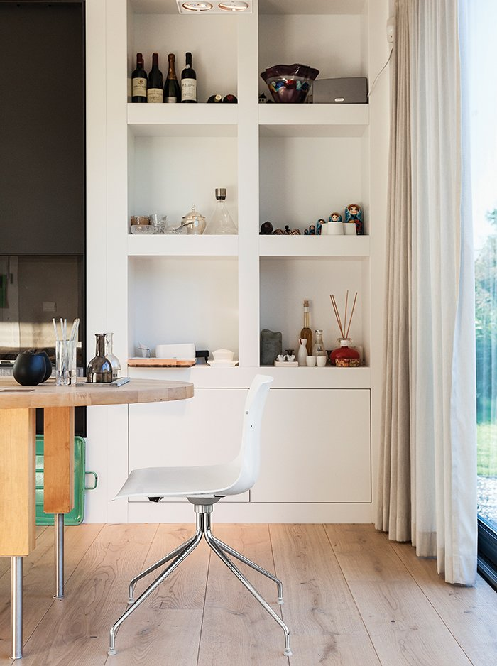 The Catifa chair in the dining area is by Arper. Tagged: Dining Room, Chair, Storage, Table, and Light Hardwood Floor.  Photo 7 of 13 in A Modern Take on the Pitched-Roof