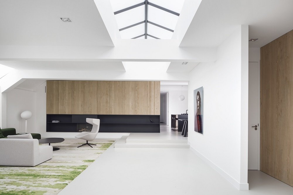 """""""We wanted to create a natural mood, like you're in a forest,"""" he says. """"We went for a more abstract reference to nature.""""  Stark white walls create the feel of wide-open space in the single story, roughly 2,500-square-foot dwelling. The white palette is offset by rough oak finishes.  Living Rooms by Lara Deam from Minimal Home Recreates Nature in the Heart of Amsterdam"""