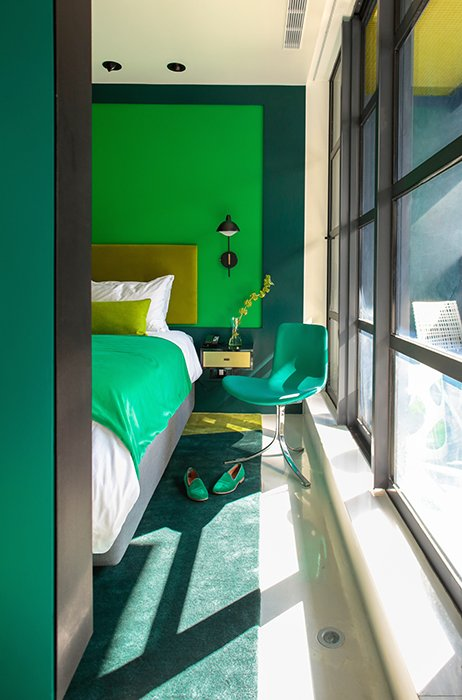 Another room is done up in shades of green.  Hospitality Favorites by Allie Weiss from Every Room is a Different Hue in This Bright Manhattan Hotel