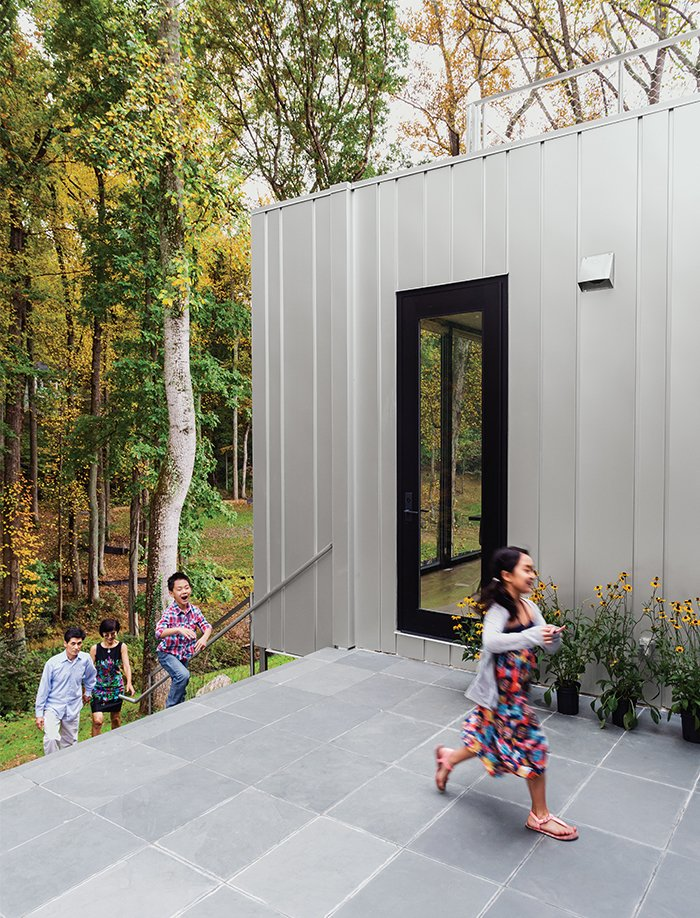 The flooring in the house alternates between seven-inch-wide oak planks and slate tile, the latter extending to the first-floor terrace.