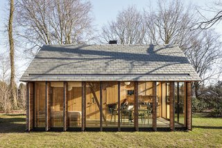 "This Light-Filled Cabin in the Netherlands Is Completely Made by Hand - Photo 1 of 9 - The west side is clad with six shutters made of horizontal, western red cedar slats that can be opened or closed with a single movement. ""We wanted it to be able to feel cozy when needed,"" Oostenbruggen says."