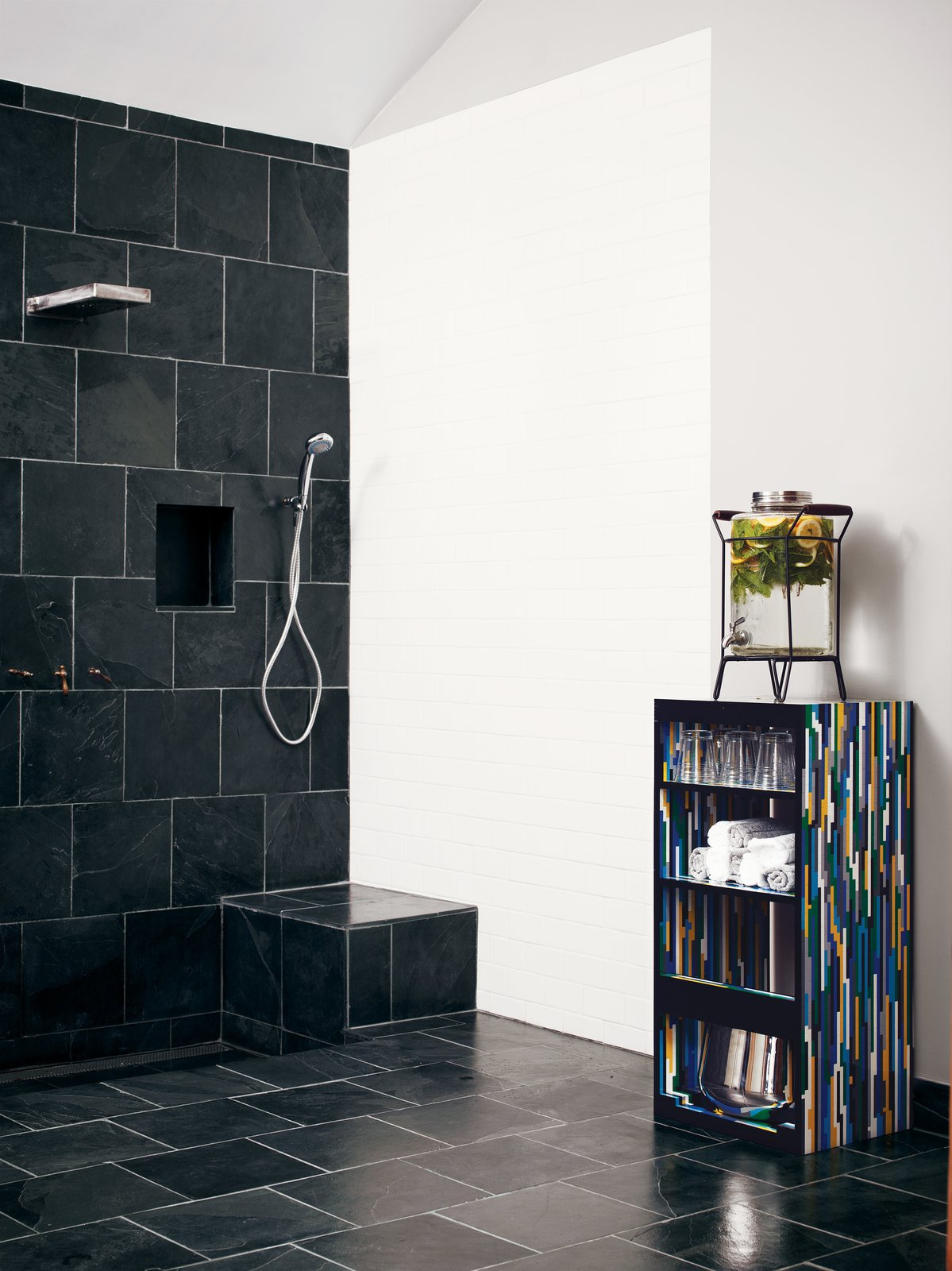 Roberts found the Montauk black slate, which he continued in a second bath. Tagged: Bath Room and Open Shower.  Photo 4 of 13 in The Tiny Hollywood Home of Mad Men's Vincent Kartheiser